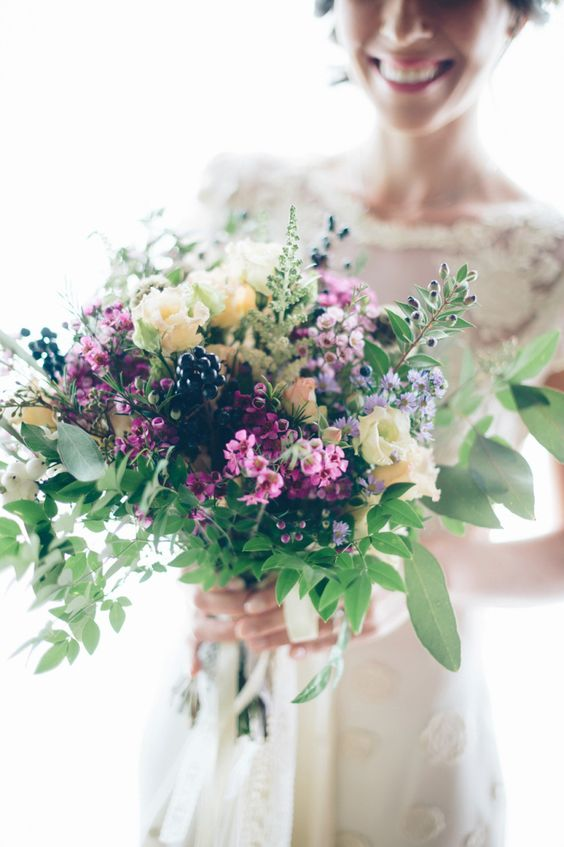 Power sized pink and purple rustic bouquet for a Tuscan wedding.  Photography by http://www.leliascarfiotti.com | Love My Dress® UK Wedding Blog