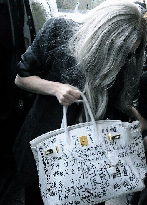 Lady Gaga with her graffiti'd Birkin