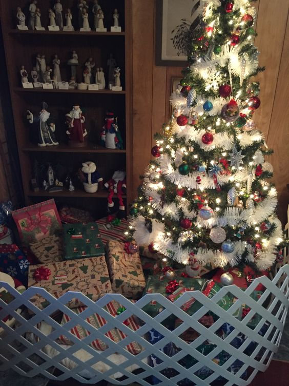 My Christmas tree and packages protected from 3 nosy cats by lattice fencing!  It works!: