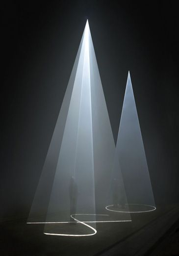 Anthony McCall. Between You and I 2006. Installation view at Peer/The Round Chapel, London, 2006  Vertical solid light installation, 32-minute cycle in two parts. Computer, QuickTime movie file, two video projectors, two haze machines