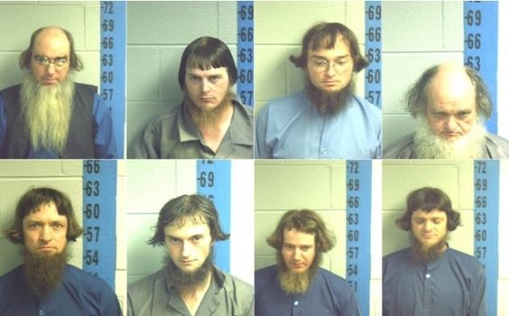 mugshots of amish who won't put orange triangles on their buggies.