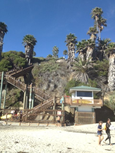 Detail of staircase with lifeguard stand nestled under the cliff.