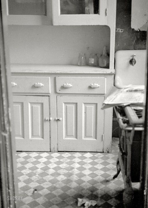 """July 1935. """"Kitchen of an apartment available for rent in the District of Columbia."""" One of hundreds of photographs taken by Carl Mydans to document housing conditions in the poorer sections of Washington, D.C., during the Depression. 35mm nitrate negative for the Resettlement Administration."""