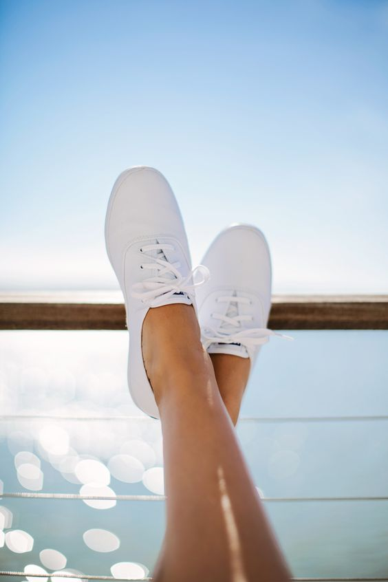 Plain White Keds for under my wedding dress. And knock offs for the bridesmaids.