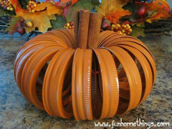 Get mason jar lids. Paint orange. Tie together. Add cinnamon sticks. Looks like a pumpkin smells like heaven.