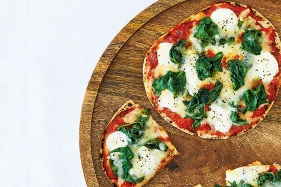 These double mozzarella and spinach pita pizzas use store-bought whole wheat pitas as quick and easy pizza crusts. Now that's a great vegetarian weeknight meal! Photo by Jeff Coulson.
