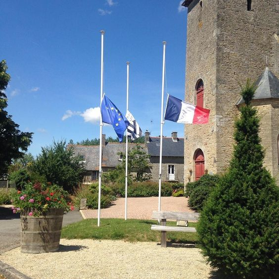 Flags at half mast today after yesterday's attack.