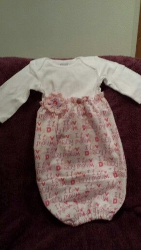 Baby gown with crochet flower.