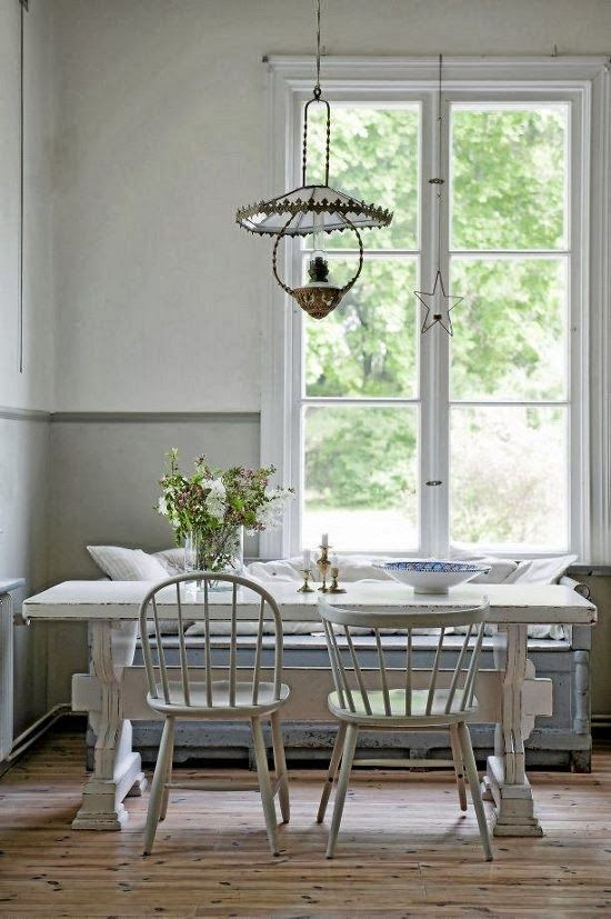 White kitchen with timeless decor: a beautiful, romantic trestle table, mismatched dining chairs, and soft pastels in a breakfast room with Swedish style and Nordic French decor. #nordicfrench #timelessdesign #breakfastnook #kitchendecor #FrenchCountry #swedish #pastels #interiordesign #trestletable #whitekitchen #scandinavian