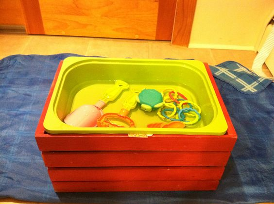 $12 DIY sensory table. Storage crate with ikea trofast bin velcroed to top! Made it today:)