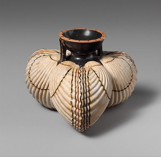 Terracotta aryballos (oil flask) in the form of three cockleshells -late 6th century BC