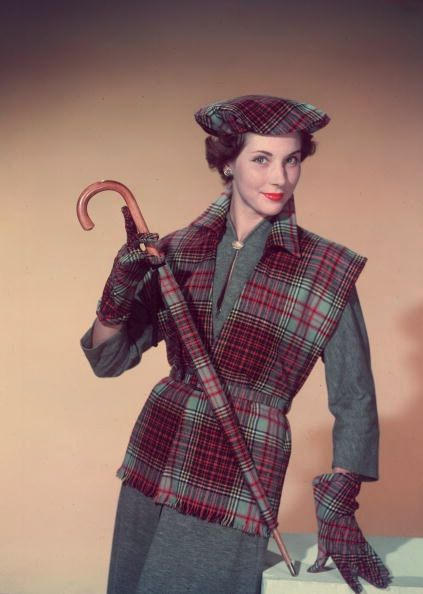 Model is wearing a tartan waistcoat with matching beret, gloves and umbrella, photo by Chaloner Woods, 1955