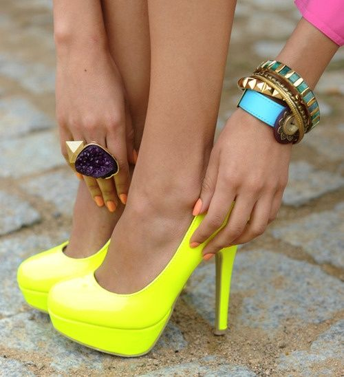 If you're going to go bold and join in on the neon trend, you might as well commit and wear platform pumps!