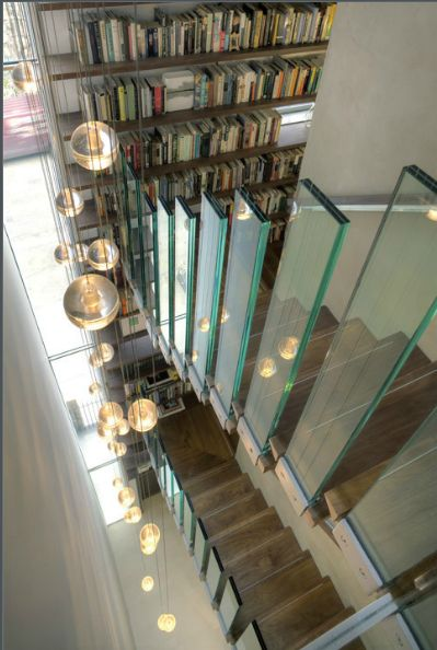 maww..... another extraordinary use of bocci lights. love the bookcase as well.