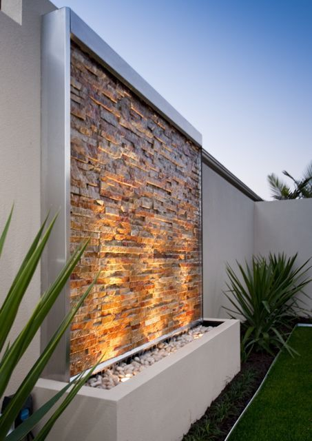 BREATHTAKING CONTEMPORARY EATER FEATURE | Stone Clad Water Wall Kit Contemporary Water Feature, Osborne Park, Western Australia | bocadolobo.com/ #contemporarydesign #contemporarydecor