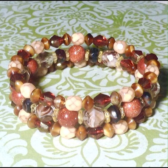 Multi stone wrap bracelet NWOT Wrap bracelet featuring goldstone and Czech glass. Warm colors that go with everything. Sayre Jewelry Bracelets