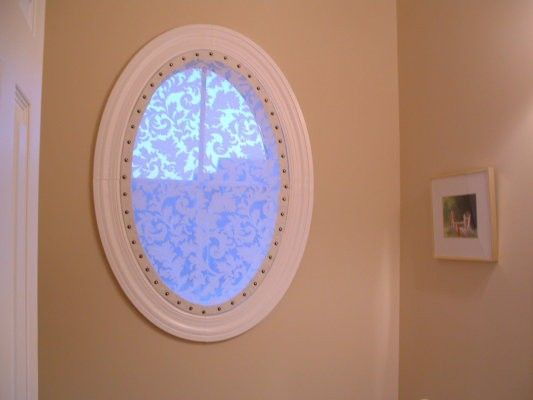 Here is a great idea i found for dealing with those oval for Oval window treatment ideas