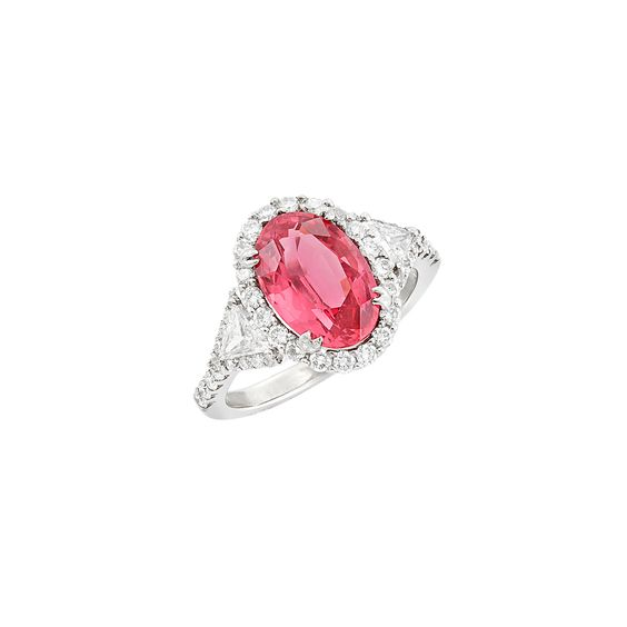 White Gold, Pink Spinel and Diamond Ring 18 kt., one oval pink spinel ap. 3.15 cts., 2 triangle-cut diamonds ap. .25 ct., 46 round diamonds ap. .85 ct., ap. 3 dwts. Size 6 3/4.