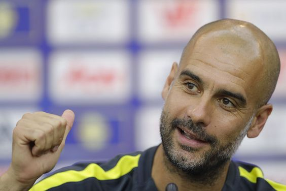 Pep Guardiola Photos Photos - Manchester City's manager Pep Guardiola attends a press conference for 2016 International Champions Cup match between Manchester City and Borussia Dortmund at Shenzhen Stadium on July 27, 2016 in Shenzhen, China. - Manchester City Pre-game Training & Press Conference