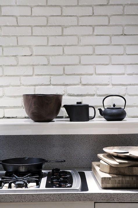 kitchens-black-white-brick-walls-cooktops-cutting-boards-tea-kettles-tea-sets