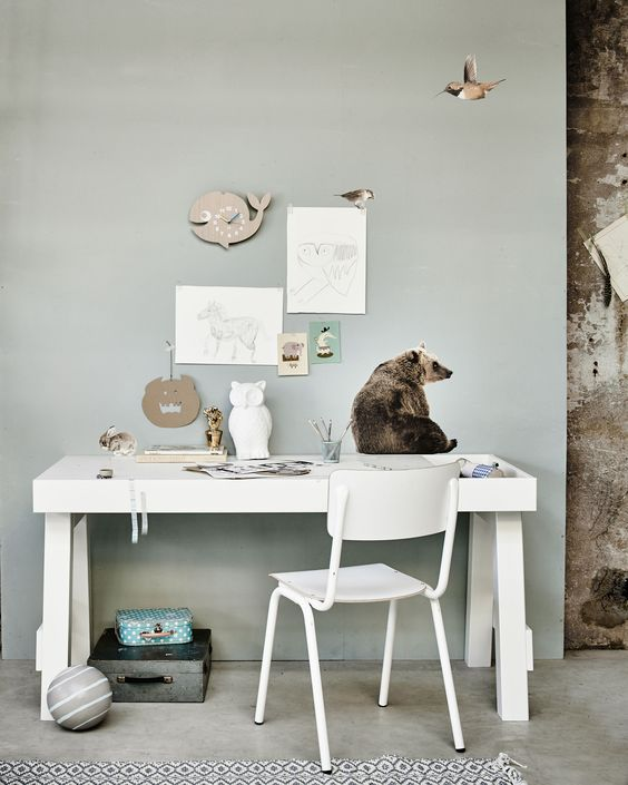 Bright workspace in an industrial building, with a white desk, white chair, wallstickers of a bear, a bird and a rabbit, and an owl lamp | Styling Fietje Bruijn, Marianne Luning, Frans Uyterlinde | vtwonen june 2015 | #vtwonenshop
