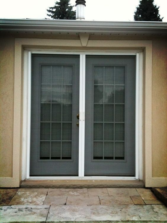 Retractable screens on double french door retractable for Retractable double screen door