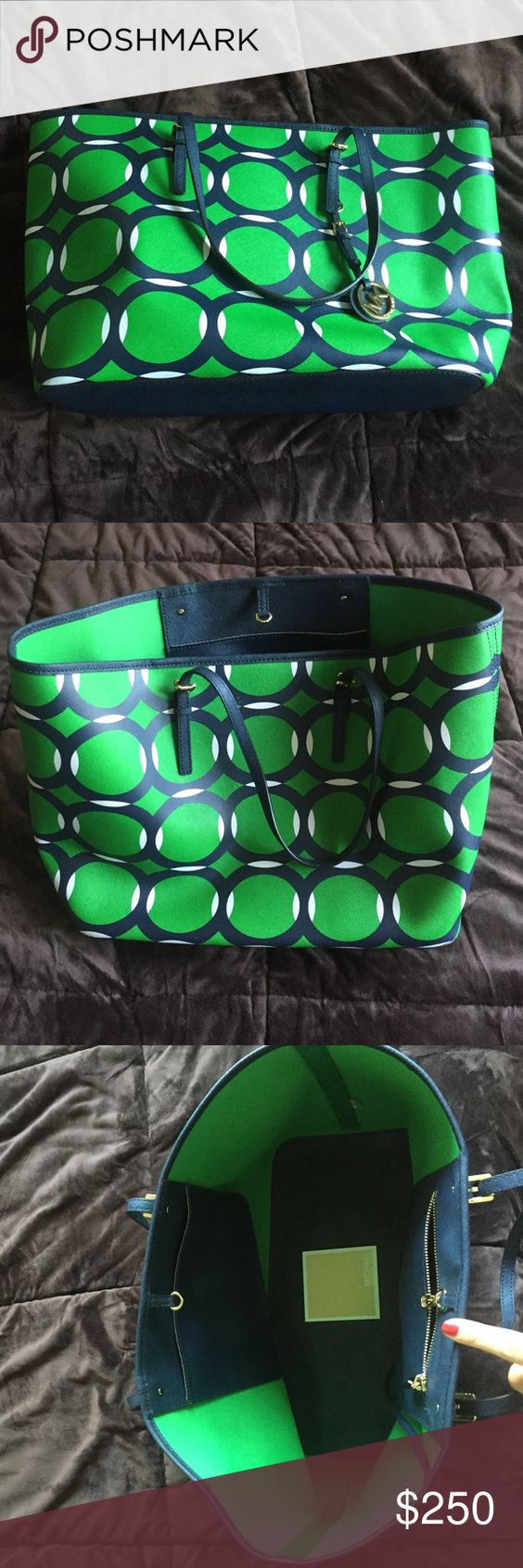 Rare design-Michael Kors navy green and white tote Rare, beautiful design-Michael Kors navy green and white tote. Measures 18.5 inches across, 11.5 inches deep. Like new condition. Great find!  You'll certainly get compliments! MICHAEL Michael Kors Bags Totes