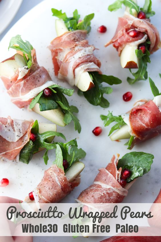 A super simple Whole30 and Paleo appetizer for holiday parties and get togethers, these prosciutto wrapped pears are the perfect blend of sweet and salty. With just a drizzle of olive oil on the peppery arugula, it becomes rich and delicious!