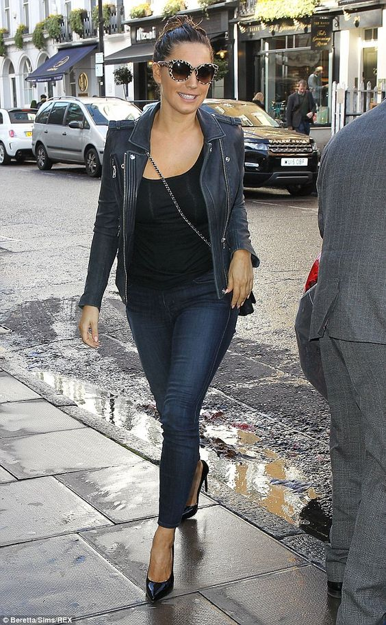 Switching it up! Earlier in the day she had a casual leather jacket on instead of her trench coat: