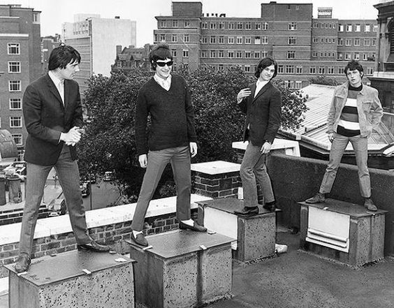 Mick Avory, Ray Davies, Dave Davies and Pete Quaife of the British rock band the Kinks standing on a London rooftop. Photo: Ray Moreton/ Getty Images 2011