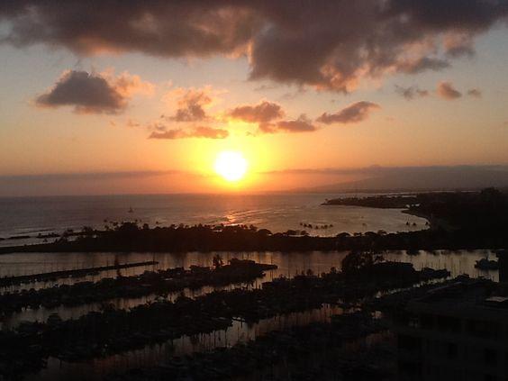 Beautiful sunset over the harbor from the Ilikai hotel in Honolulu Hawaii