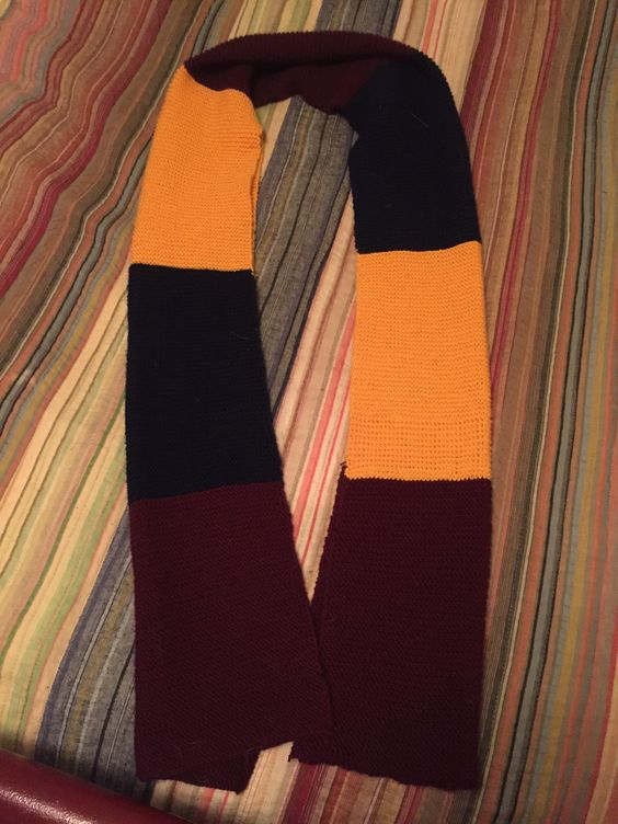 Tri-colored scarf, size 3 needles 70 stitches, 98 rows per color (scarf is folded in half in picture)
