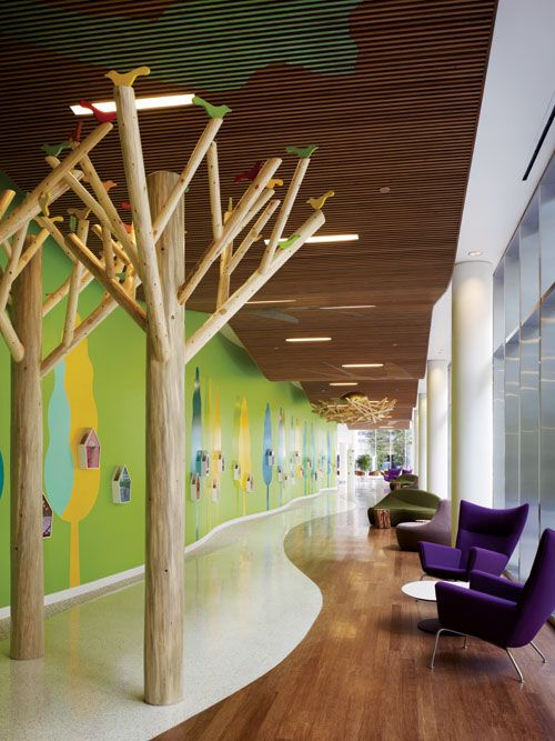All spaces are learning spaces! How might we make the hallways zones for collaboration while still meeting fire code? Nature + light + + breaks up long hallway + collaboration space = love it! (Randall Children's Hospital — a ZGF building in Portland, Oregon):