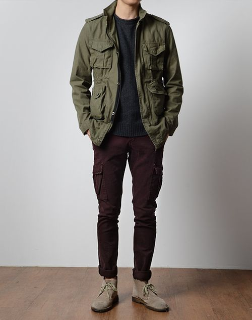 "The seemingly ""vintage"" look of the M-65/field/fatigue jacket is a great and versatile piece to own. It pairs greatly with a pair of boots (in this case, some Clarks suede desert boots) and can work in a variety of styles. In the Trooper, the wine/burgundy color of the chinos creates a unique, yet appealing interaction of colors along with the neutral tone of the sand suede desert boots.:"