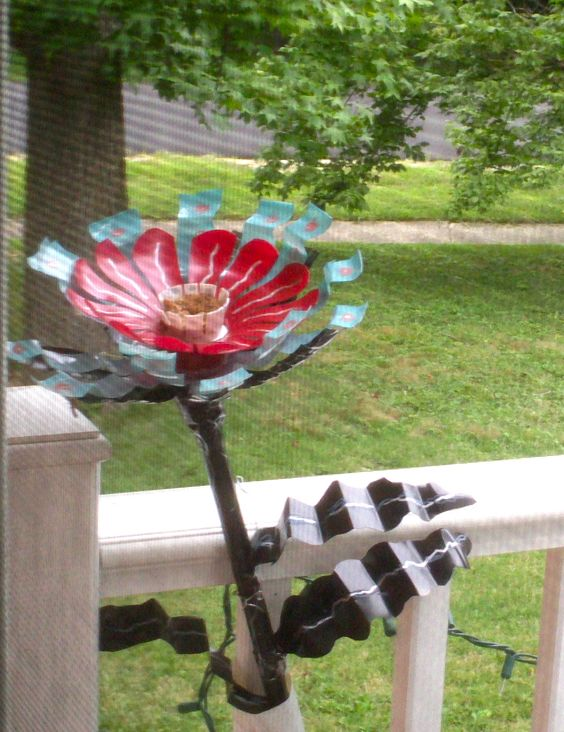 flowers made from recycled (upcycled) plastic bottles make an attractive holder for yellow jacket bait (that rid our deck of these ominous intruders)