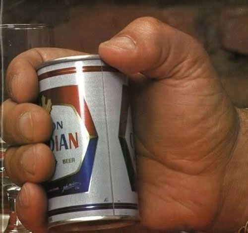I'd be torn between surgically altering my hands to be this huge and requiring my beer guy to provide mini cans.