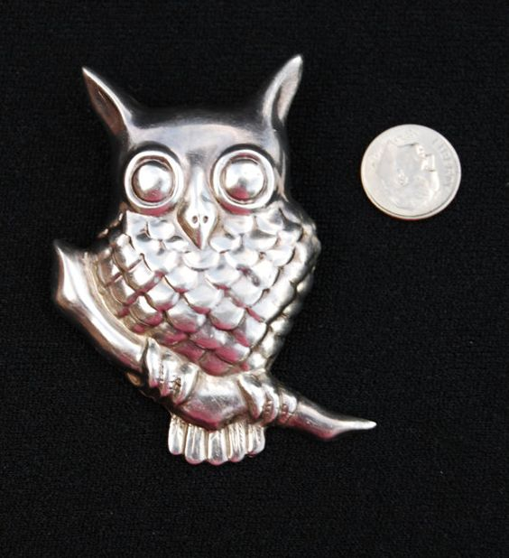 Check out this item in my Etsy shop https://www.etsy.com/listing/251011119/halloween-owl-pendant-sterling-silver