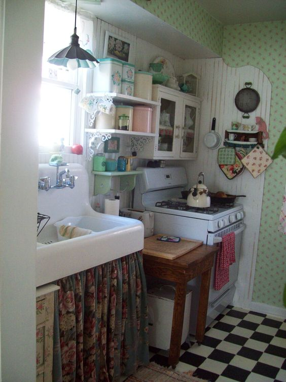 this is my (robin) small cottage kitchen..yet it's efficient and comfortable and fun to cook in...great view out the window too..of a cottage garden...the best way to stand at the kitchen sink!!!!