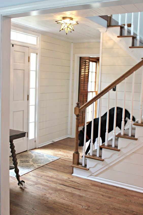Two Story Foyer Paneling : Gorgeous paneled foyer you won t believe how they did it