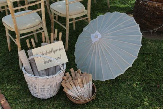 Wedding parasols and fans a 'must have' for weddings here in Spain