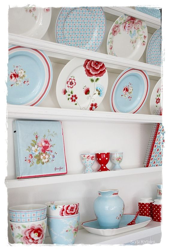 Pretty display of pale blue and red china for a bright and contemporary country look.