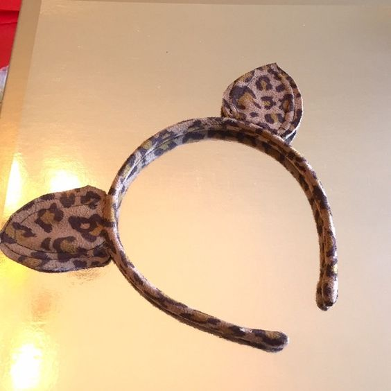 Cat ears -- leopard print-- Urban Outfitters Cute leopard printed cat ears headband from Urban! Urban Outfitters Accessories Hair Accessories