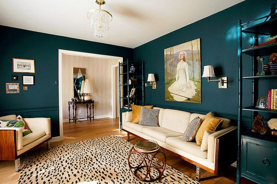 Erin - Design Crisis  Deep Teal living room with animal print rug. Oh god yes.