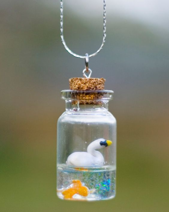 Bottle necklace swans and polymers on pinterest for Things to make out of glass