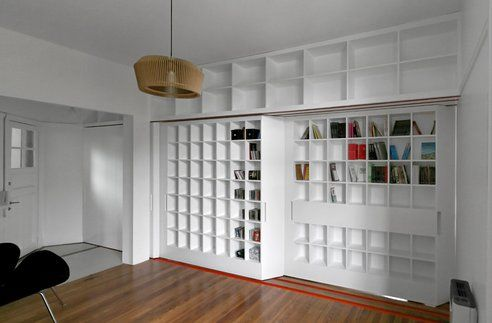 Sliding Library Instantly Creates Extra Studio at Hip Buenos Aires Apartmen