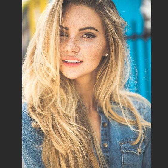 Blonde hair, Hazel eyes, freckles.