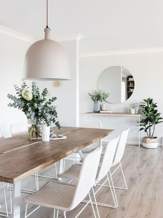 minimalist dining room // white and light wood dining room // pendant light // light wash wood floors // farmhouse table // round mirror
