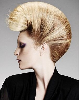 A long blonde straight coloured sculptured updo beehive hairstyle by Millers