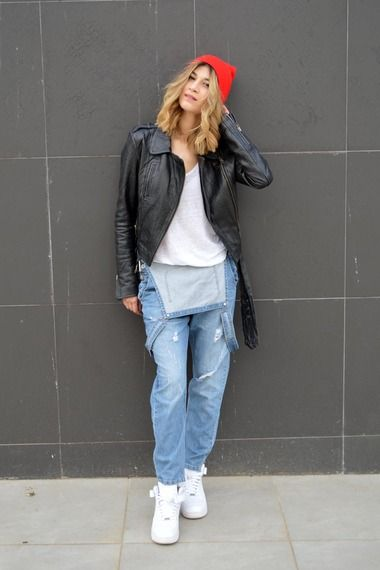 Street Style: 90s denim dungarees with leather biker jacket and comfy high top trainers