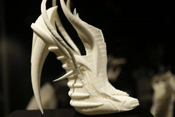 """This Feb. 11, 2013 photo shows Janina Alleyne's """"Exoskeleton"""" shoe on display at the """"Shoe Obsession"""" exhibit at The Museum at the Fashion Institute of Technology Museum in New York. The exhibition, s"""